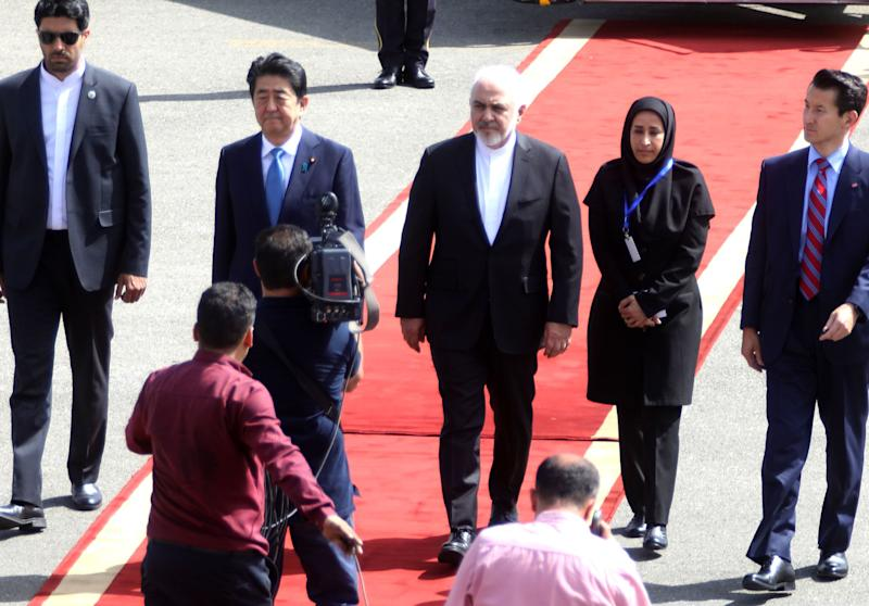 Japan's Prime Minister Shinzo Abe is greeted by Iran's Foreign Minister Mohammad Javad Zarif at Tehran's Mehrabad airport on June 12, 2019. Abe arrived in Tehran for a rare diplomatic mission, hoping to defuse tensions between the Islamic republic and Tokyo's ally Washington.