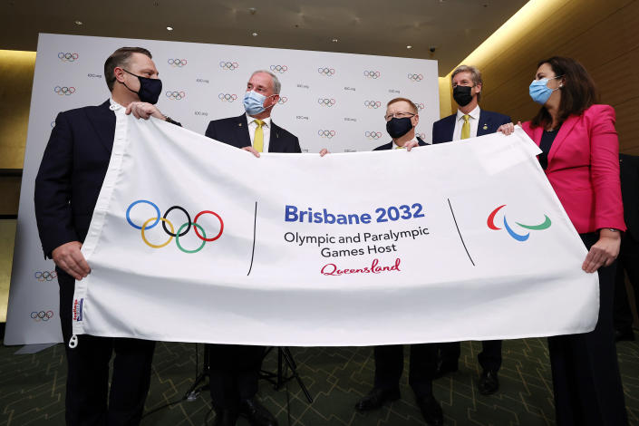 The Right Honourable the Lord Mayor of Brisbane, Councillor Adrian Schrinner, Senator the Honourable Richard Colbeck, Minister for Senior Australians and Aged Care Services and Minister for Sport, John Coates AC, President, Australian Olympic Committee, three time Olympic gold medalist James Tomkins and The Honourable Annastacia Palaszczuk MP, Premier of Queensland and Minister for Trade, attend a press conference after Brisbane was announced as the 2032 Summer Olympics host city during the IOC Session at Hotel Okura in Tokyo, Wednesday, July 21, 2021. (Toru Hanai/Pool Photo via AP)