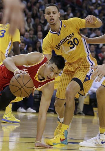 Houston Rockets' Jeremy Lin, left, drives the ball against Golden State Warriors' Stephen Curry (30) during the first half of an NBA basketball game Friday, March 8, 2013, in Oakland, Calif. (AP Photo/Ben Margot)