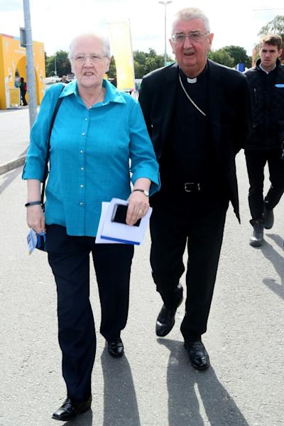 Marie Collins (L), a former member of the Pontifical Commission for Protection of Minors, walks with Archbishop of Dublin Diarmud Martin (R) after taking part in a panel discussion on 'Safeguarding Children and Vulnerable Adults' during the 2018 World Meeting of Families in Dublin
