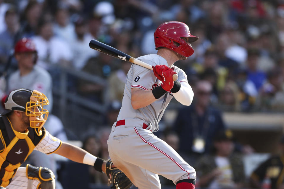 Cincinnati Reds' Tyler Naquin hits an RBI single off San Diego Padres relief pitcher Daniel Camarena in the fifth inning of a baseball game Saturday, June 19, 2021, in San Diego. Jonathan India scored on the play. (AP Photo/Derrick Tuskan)