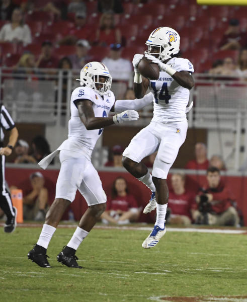 San Jose State defender Bobby Brown (14) makes an interception next to teammate Tre Webb during the first half of an NCAA college football game against Arkansas, Saturday, Sept. 21, 2019 in Fayetteville, Ark. (AP Photo/Michael Woods)