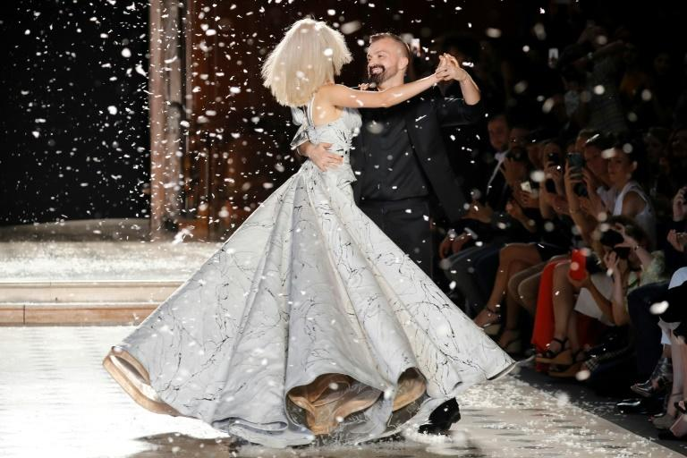 Wedding bell: French fashion designer Julien Fournie dances with a model wearing a wedding dress at his Paris haute couture show (AFP Photo/FRANCOIS GUILLOT)