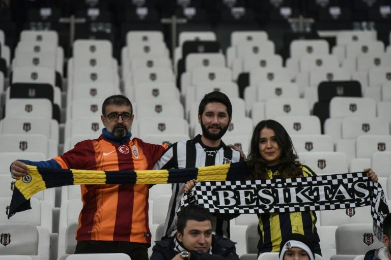 Besiktas, Fenerbahce and Galatasaray's supporters cheer prior to the Ziraat Turkish Cup football match between Besiktas and Kayserispor on December 14, 2016