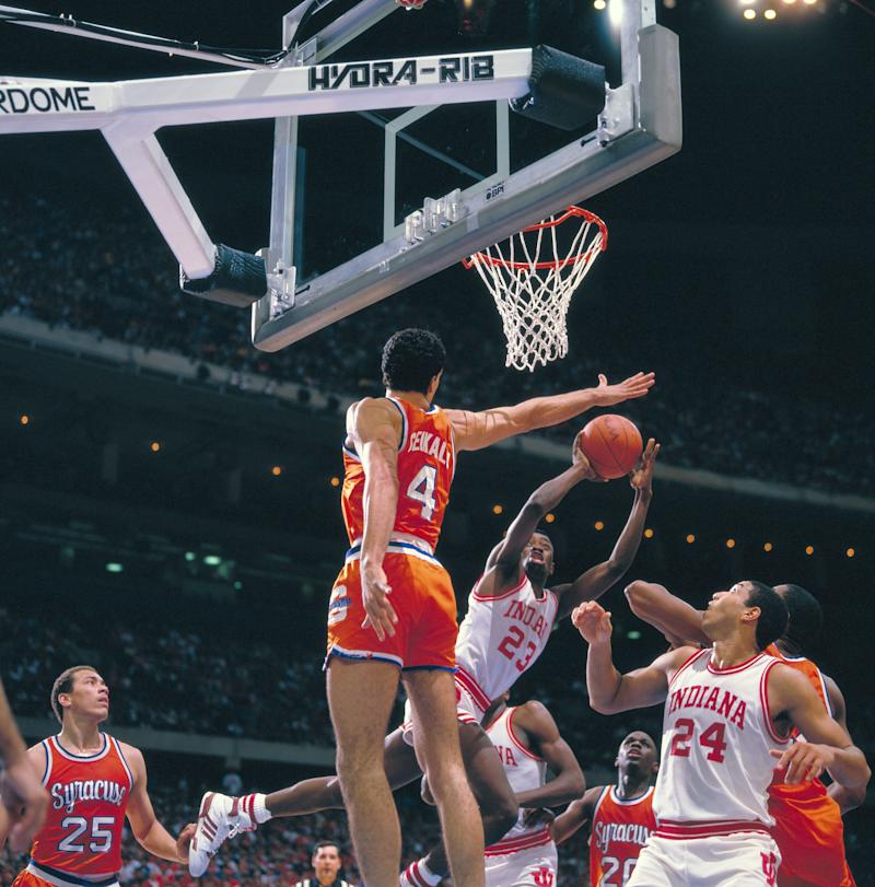 Syracuse's Rony Selkaly (4) and Indiana guard Keith Smart (23), Indiana forward/center Daryl Thomas (24) during the 1987 NCAA men's basketball championship game held at the Louisiana Superdome. Smart was named MVP for the tournament. (Photo by Rich Clarkson/NCAA Photos via Getty Images.)
