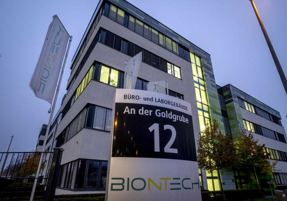 """File -- In this Tuesday, Nov.10, 2020 file photo windows are illuminated at the headquarters of the German biotechnology company """"BioNTech"""" in Mainz, Germany. Germany prepares for the vaccination of the German population during the upcoming month. (AP Photo/Michael Probst, file)"""