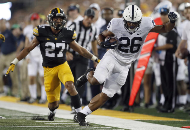 Saquon Barkley, right, is unable to stay in bounds as Iowa defensive back Amani Hooker watches during the first. (AP)