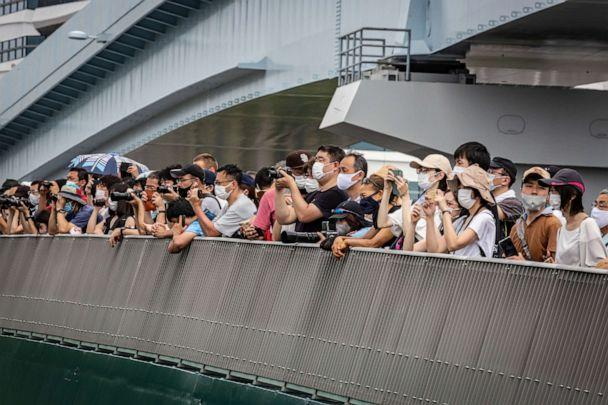 PHOTO: Spectators gather to watch the Men's BMX Freestyle seeding event from a nearby bridge on July 31, 2021 in Tokyo, Japan. (Yuichi Yamazaki/Getty Images)