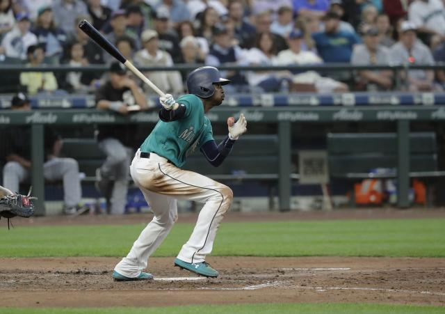 Seattle Mariners' Dee Gordon watches his ball after making contact against the Chicago White Sox during a baseball game, Friday, July 20, 2018, in Seattle. (AP Photo/Ted S. Warren)