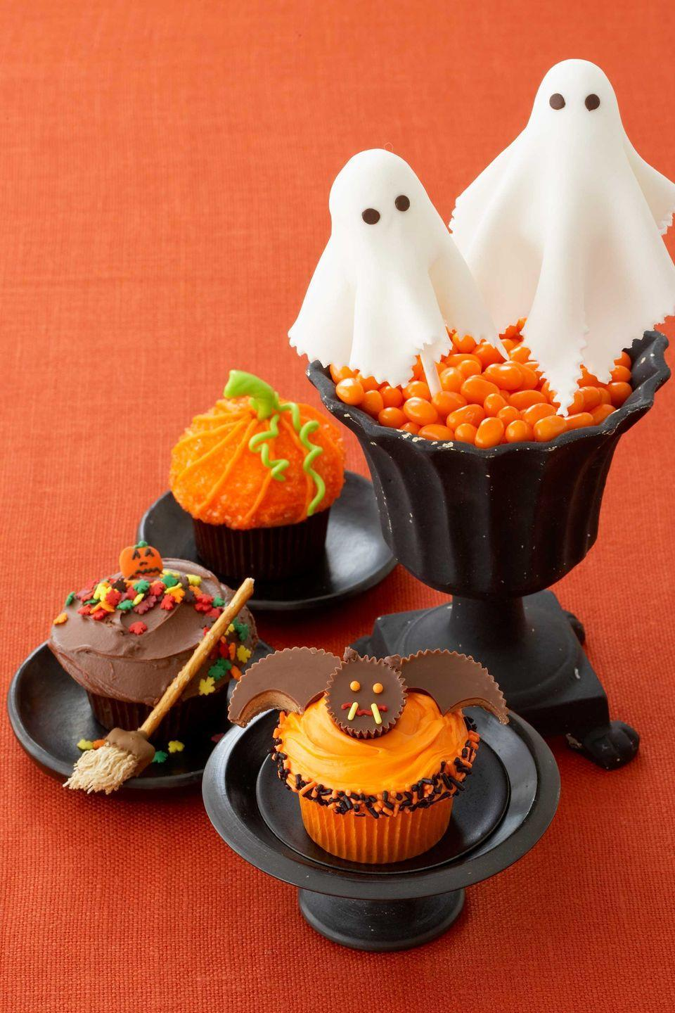 """<p>A few strategically placed peanut butter cups turn a basic cupcake into something spook-tacular.</p><p><em><a href=""""https://www.womansday.com/food-recipes/food-drinks/recipes/a10778/creepy-cupcakes-recipe-122165/"""" rel=""""nofollow noopener"""" target=""""_blank"""" data-ylk=""""slk:Get the Peanut Butter Cup Bat Cupcakes recipe."""" class=""""link rapid-noclick-resp"""">Get the Peanut Butter Cup Bat Cupcakes recipe.</a></em></p>"""
