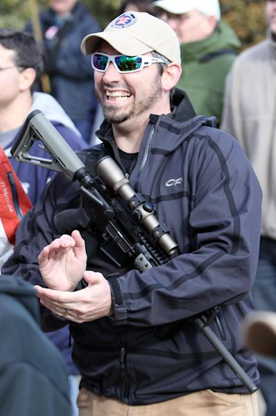 Caleab Spencer of Newmarket, N.H. cheers during a rally to promote the right to bear arms in front of the Statehouse in Concord, N.H. Thursday Jan. 31, 2013. Speakers criticized Democrats in Washington for favoring new gun control laws following the Connecticut school shooting that left 26 dead last month. (AP Photo/Jim Cole)