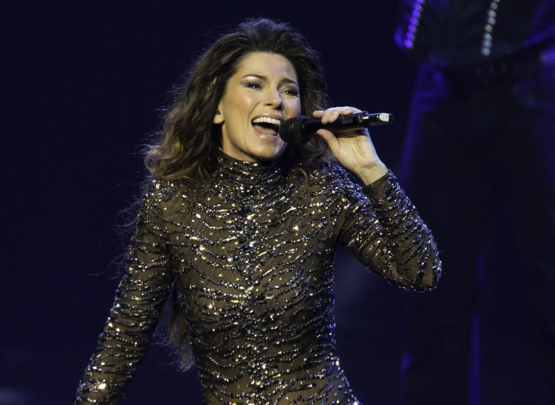 """FILE - This Dec. 1, 2012 file photo shows Shania Twain performing at The Colosseum at Caesars Palace in Las Vegas. Twain has announced 22 new show dates this fall to round out the first year of her two-year Las Vegas Strip residency. Twain said, Monday, May 6, 2013, that the show at Caesars Palace is """"a dream performance scenario"""" that allows her to balance her roles as a mother and as a country superstar. The 47-year-old Canadian singer known for """"Any Man of Mine"""" and """"That Don't Impress Me"""" made a grand entrance into Sin City on horseback and returned to the stage in December after nearly a decade in hiatus.  (Photo by Eric Jamison/Invision/AP, file)"""