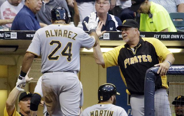 Pittsburgh Pirates' Pedro Alvarez is congratulated by manager Clint Hurdle after Alvarez hit a three-run home run during the fourth inning of a baseball game against the Milwaukee Brewers on Saturday, Aug. 23, 2014, in Milwaukee. (AP Photo/Morry Gash)