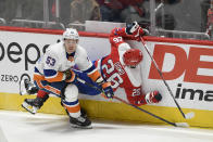 Washington Capitals center Nic Dowd (26) collides into the boards next to New York Islanders center Casey Cizikas (53) during the first period of an NHL hockey game, Monday, Feb. 10, 2020, in Washington. (AP Photo/Nick Wass)