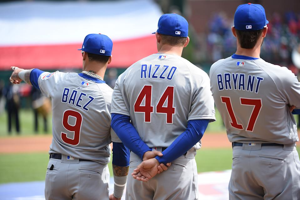 ARLINGTON, TX - MARCH 28:  Javier Baez #9, Anthony Rizzo #44 and Kris Bryant #17 of the Chicago Cubs are seen during player introductions before the game between the Chicago Cubs and the Texas Rangers at Globe Life Park in Arlington on Thursday, March 28, 2019 in Arlington, Texas. (Photo by Cooper Neill/MLB via Getty Images)