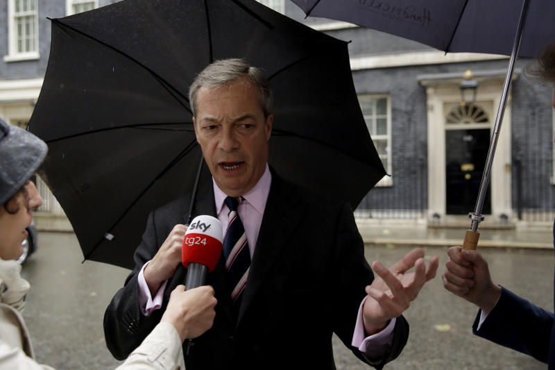 """Nigel Farage the leader of Britain's Brexit Party gives a television interview after delivering a letter addressed to """"The Prime Minister"""" asking for the Brexit Party to be included in Brexit negotiations with the European Union (EU) outside 10 Downing Street in London, Friday, June 7, 2019. Farage's Brexit Party came close to winning its first seat in Parliament on Friday, narrowly losing to Labour in a special election in the eastern England city of Peterborough. (AP Photo/Matt Dunham)"""
