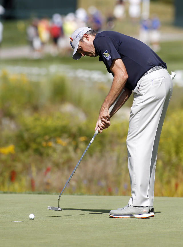 Matt Kuchar putts on the 16th green during the second round of the Deutsche Bank Championship golf tournament in Norton, Mass., Saturday, Aug. 30, 2014. (AP Photo/Stew Milne)