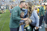 Green Bay Packers coach Matt LaFleur greets his family on the sideline prior to the team's NFL preseason football game against the Houston Texans on Thursday, Aug. 8, 2019, in Green Bay, Wis. (AP Photo/Mike Roemer)