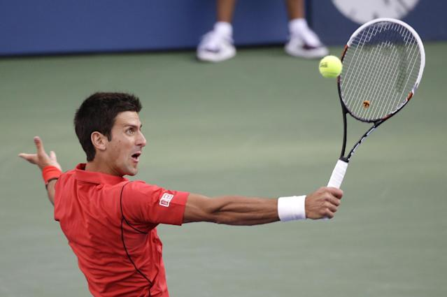 Novak Djokovic, of Serbia, returns a shot to Rafael Nadal, of Spain, during the men's singles final of the 2013 U.S. Open tennis tournament, Monday, Sept. 9, 2013, in New York. (AP Photo/Mike Groll)
