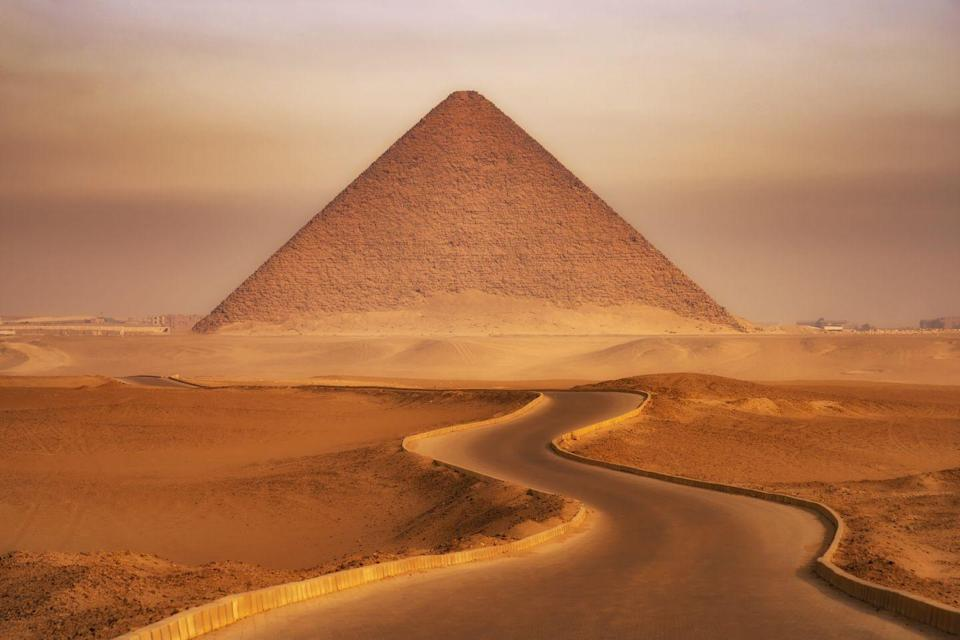 """<p>In <a href=""""https://www.history.com/topics/ancient-history/the-egyptian-pyramids"""" rel=""""nofollow noopener"""" target=""""_blank"""" data-ylk=""""slk:ancient Egyptian culture"""" class=""""link rapid-noclick-resp"""">ancient Egyptian culture</a>, kings were viewed as divine beings. When it came time to design their eternal resting place, pyramids were built with angled sides to emulate the rays of the sun. They believed this helped the king's soul ascend to the heavens. </p>"""