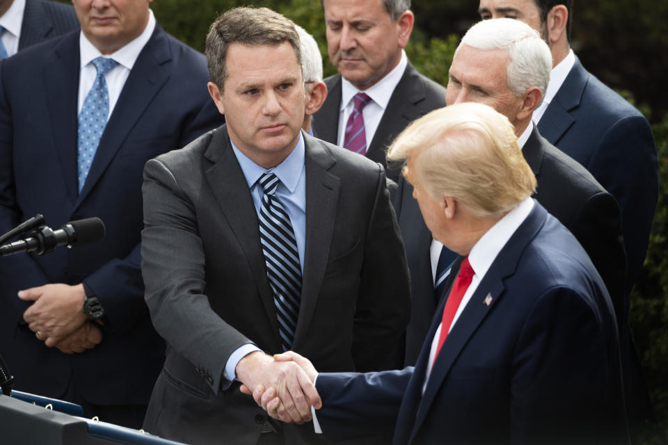 President and CEO of Walmart Inc. Doug McMillon (C) shakes hands with US President Donald Trump during press conference on COVID-19, known as the coronavirus, in the Rose Garden of the White House in Washington, DC, March 13, 2020. - Trump is declaring coronavirus a national emergency. (Photo by JIM WATSON / AFP) (Photo by JIM WATSON/AFP via Getty Images)