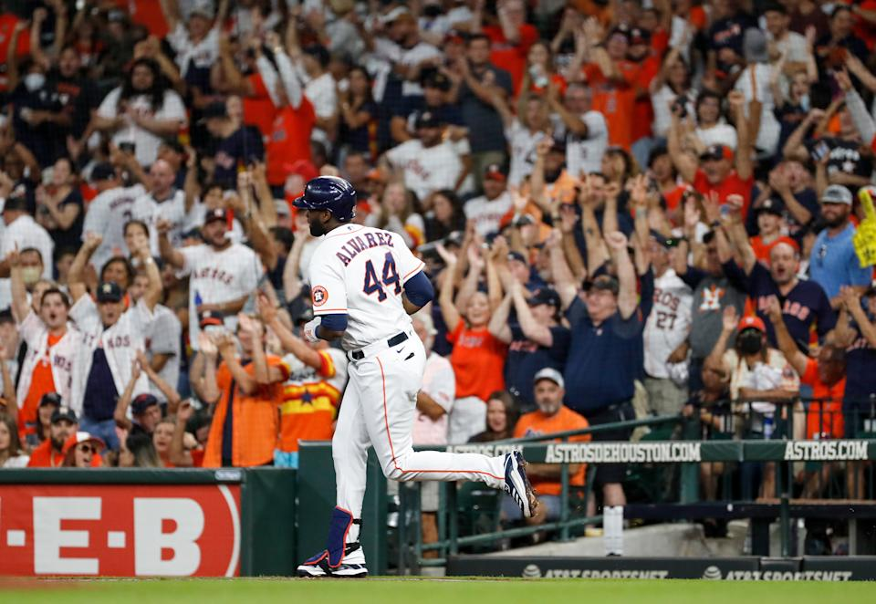 HOUSTON, TEXAS - OCTOBER 02: Yordan Alvarez #44 of the Houston Astros hits a three run home run in the first inning against the Oakland Athletics at Minute Maid Park on October 02, 2021 in Houston, Texas. (Photo by Tim Warner/Getty Images)