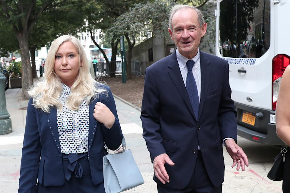 Lawyer David Boies arrives with his client Virginia Giuffre for hearing in the criminal case against Jeffrey Epstein, who died this month in what a New York City medical examiner ruled a suicide, at Federal Court in New York, U.S., August 27, 2019. REUTERS/Shannon Stapleton