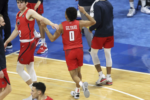 Richmond's Jacob Gilyard (0) celebrates as he runs off the court after his team defeated Kentucky in an NCAA college basketball game in Lexington, Ky., Sunday, Nov. 29, 2020. (AP Photo/James Crisp)