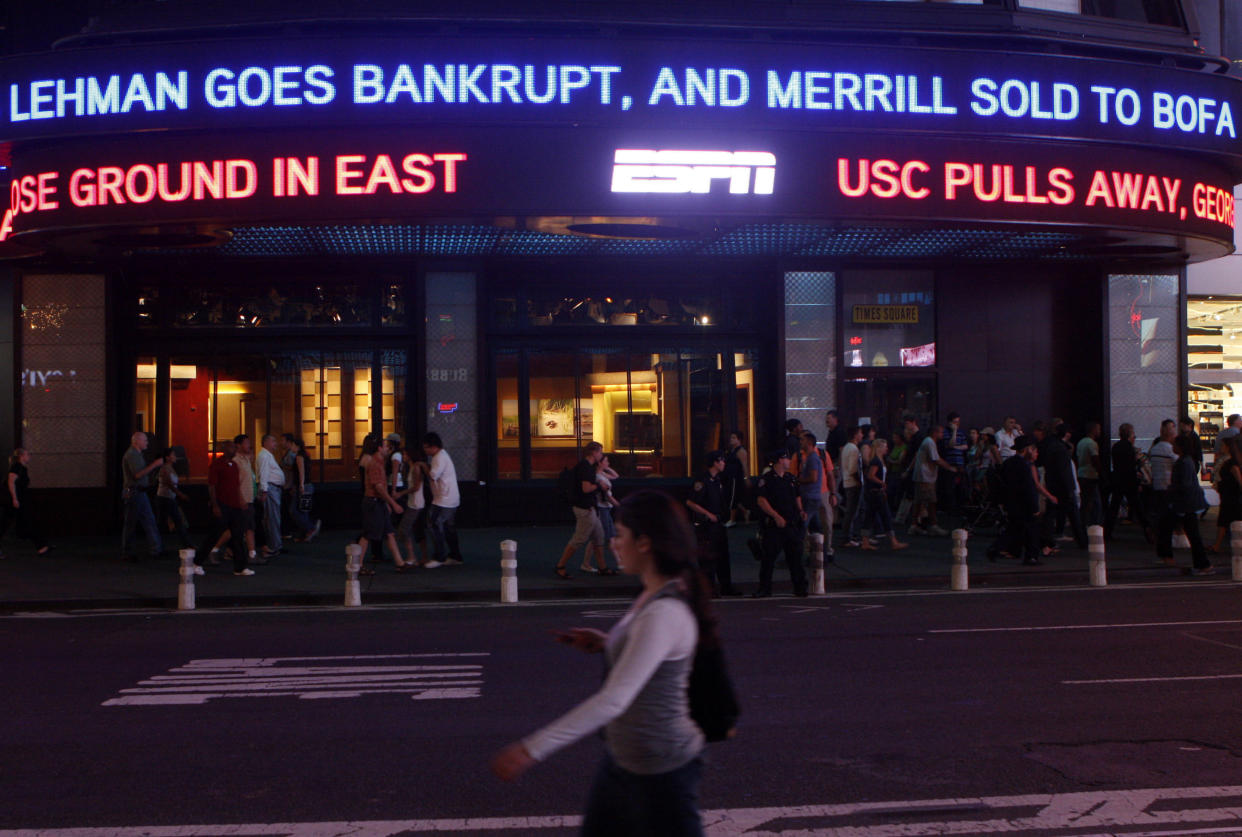 The Lehman Brothers name moves across a news ticker in Times Square in New York City on Sept. 15, 2008. (Photo: Joshua Lott/Reuters)
