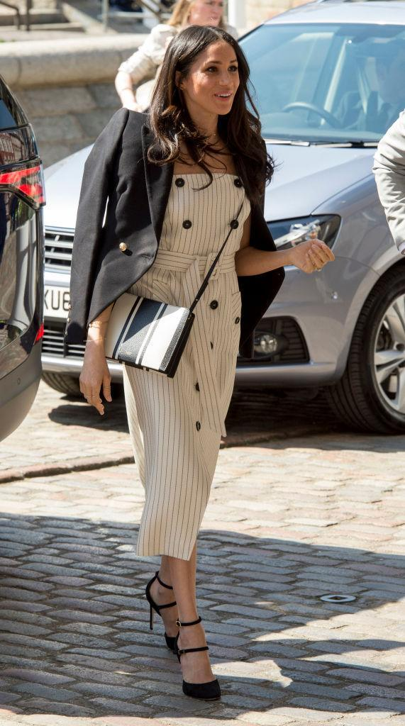 <p>For her biggest royal engagement to date, Meghan Markle wore her greatest look yet. Embracing the capital's sunshine, the royal-to-be donned a striped dress by Altuzarra with a Camilla and Marc blazer draped across her shoulders. Love. <em>[Photo: Getty]</em> </p>