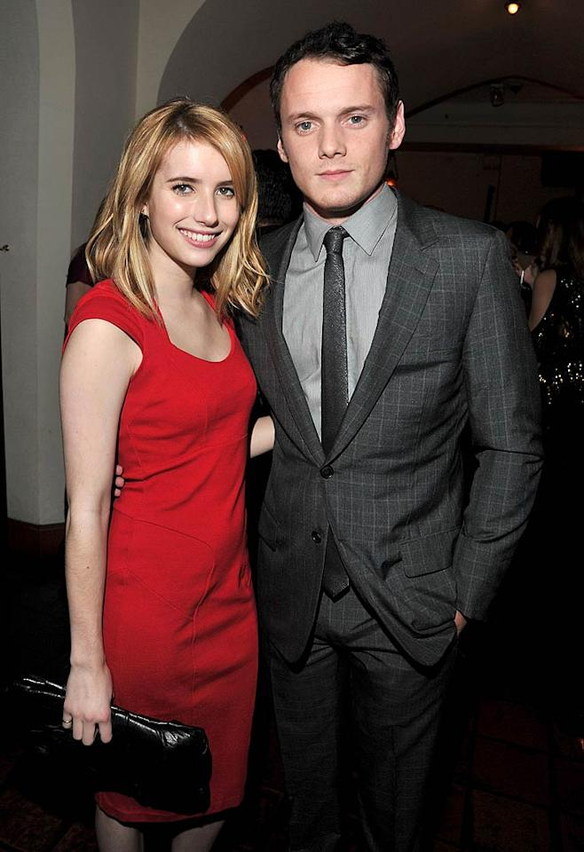 """Emma Roberts, 20, looked a little too ready for the office in her business-like dress while taking a photo op with """"Like Crazy"""" star Anton Yelchin. (11/17/2011)"""