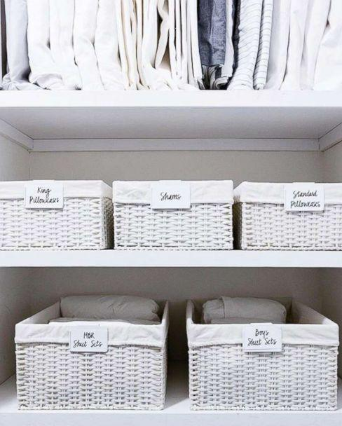 PHOTO: A linen closet organized by The Home Edit founders is pictured. (@thehomeedit)