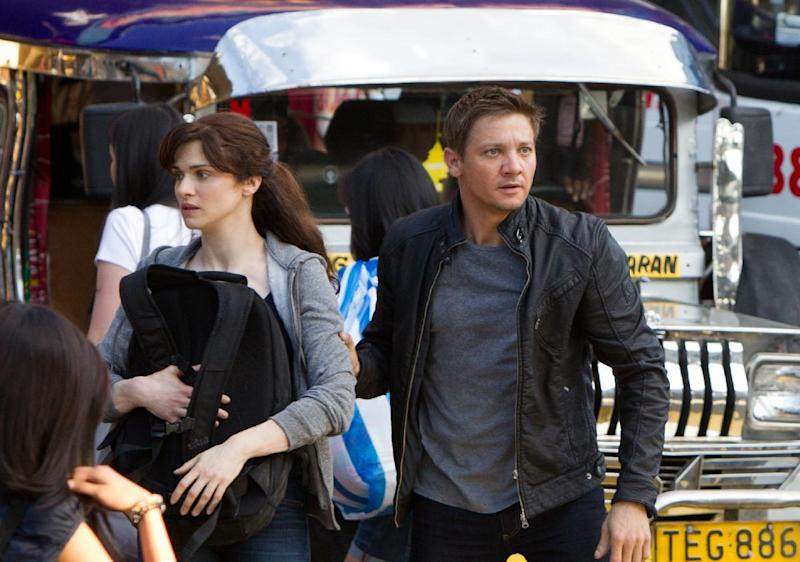 """This film image released by Universal Pictures shows Rachel Weisz as Dr. Marta Shearing, left, and Jeremy Renner as Aaron Cross in a scene from """"The Bourne Legacy."""" (AP Photo/Universal Pictures, Mary Cybulski)"""