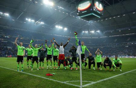 Football Soccer - Schalke 04 v Ajax Amsterdam - UEFA Europa League Quarter Final Second Leg - Veltins-Arena, Gelsenkirchen, Germany - 20/4/17 Ajax players celebrate after the match  Reuters / Thilo Schmuelgen Livepic