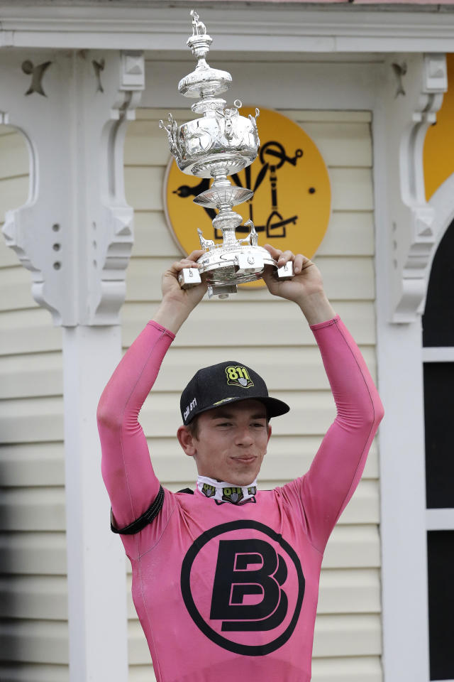 Tyler Gaffalione holds the Woodlawn Vase after riding War of Will to a win during the 144th Preakness Stakes horse race at Pimlico race course, Saturday, May 18, 2019, in Baltimore. (AP Photo/Steve Helber)