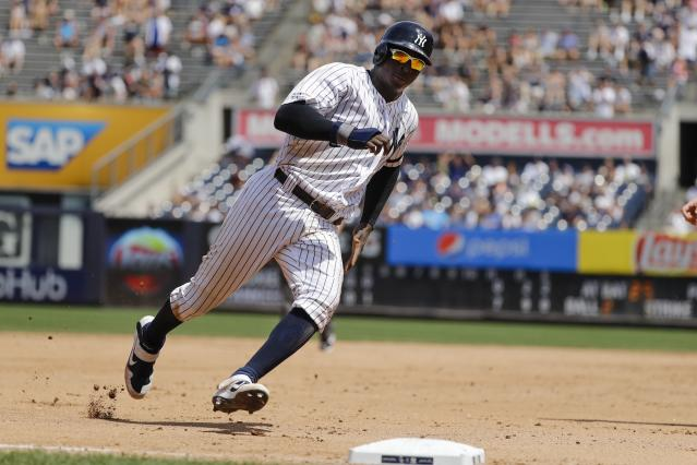 New York Yankees' Didi Gregorius runs past third base to score on a single by Gleyber Torres during the fourth inning of a baseball game against the Colorado Rockies Saturday, July 20, 2019, in New York. (AP Photo/Frank Franklin II)