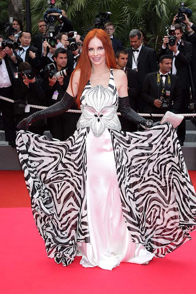 """We'll never know how Phoebe Price, an F-lister whose screen credits include """"Customer with Car"""" on """"The X Files"""" and """"Photographer"""" on """"Arli$$,"""" got invited to a red carpet event at the Cannes Film Festival, but we're eternally grateful for her offensive outfit selection. Daniele Venturelli/<a href=""""http://www.wireimage.com"""" target=""""new"""">WireImage.com</a> - May 17, 2008"""