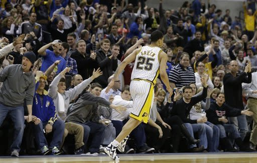 Indiana Pacers' Gerald Green (25) reacts with fans after hitting a shot late the second half of an NBA basketball game against the Atlanta Hawks Monday, March 25, 2013, in Indianapolis. The Pacers defeated the Hawks 100-94. (AP Photo/Darron Cummings)