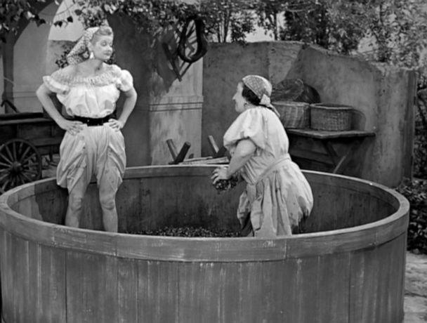 PHOTO: Lucille Ball, as Lucy Ricardo, and Teresa Tirelli, as Wine Stomper, in 'Lucy's Italian Movie'. (CBS Photo Archive/Getty Images, FILE)