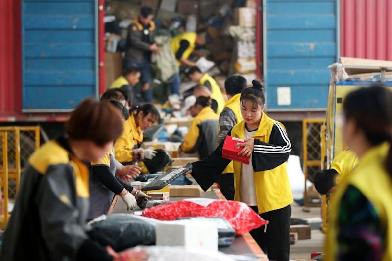 Employees sorting packages ahead of Singles Day in Huaibei in China's eastern Anhui province on Nov. 9, 2017.