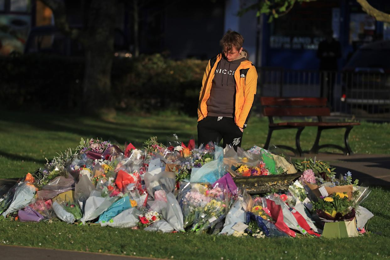Patrick James, the son of PCSO Julia James, looks at floral tributes left near her family home in Snowdown, near Aylesham, East Kent. Picture date: Tuesday May 4, 2021.