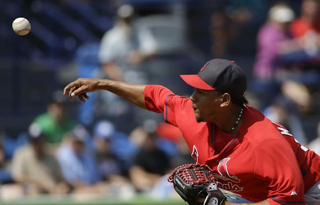 St. Louis Cardinals pitcher Carlos Martinez throws in the first inning of an exhibition spring training baseball game against the New York Mets, Wednesday, March 12, 2014, in Port St. Lucie, Fla. (AP Photo/David Goldman)