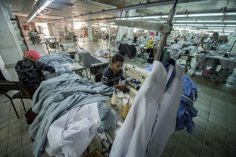 A tailor sews cotton shirts at the Marie Louis clothing and textile factory in the 10th of Ramadan city, about 60 kilometres north of Cairo, on July 29, 2018