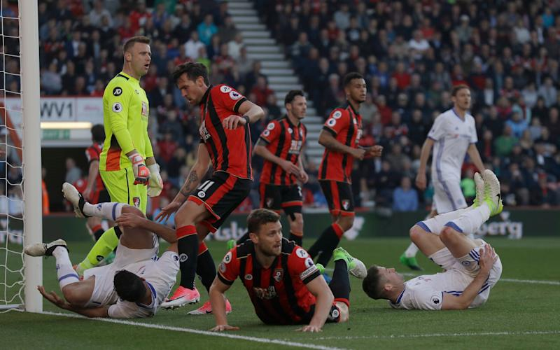 bournemouth players on the floor next to chelsea players - Credit: AP