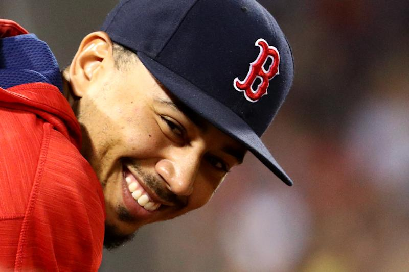 Why is Mookie Betts smiling? He'll be making $10.5 million next season after winning his arbitration case against the Red Sox. (Getty Images)