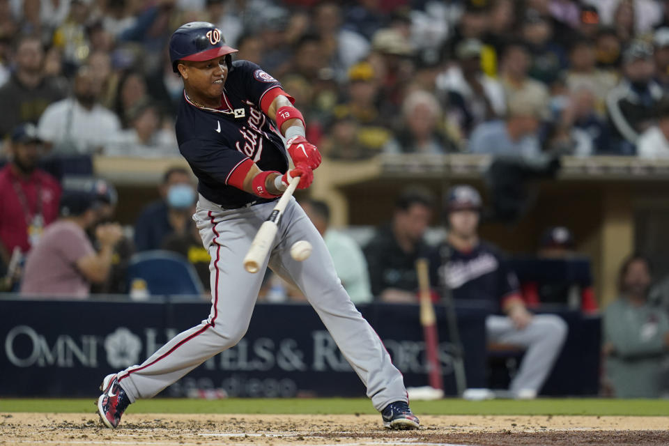 Washington Nationals' Starlin Castro hits a two-RBI single during the second inning of a baseball game against the San Diego Padres, Wednesday, July 7, 2021, in San Diego. (AP Photo/Gregory Bull)