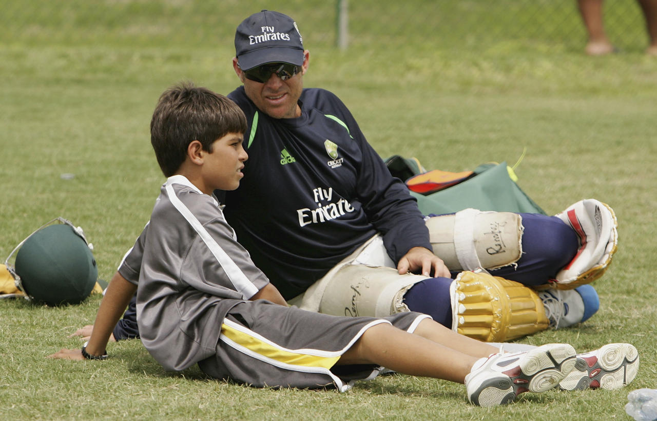 ST JOHN'S, ANTIGUA AND BARBUDA - MARCH 26:  Matthew Hayden of Australia chats with yound local Jody Maginley during training at the Sir Vivian Richards Grounds on March 26, 2007, in St John's, Antigua and Barbuda.  (Photo by Hamish Blair/Getty Images)