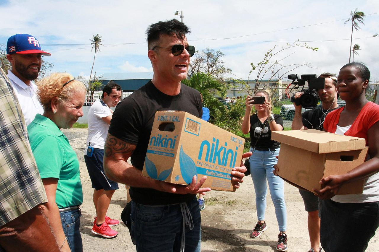 <p>The singer, who's a native of Puerto Rico, helped deliver supplies to those devastated by Hurricane Maria. (Photo: Gladys Vega/Getty Images) </p>