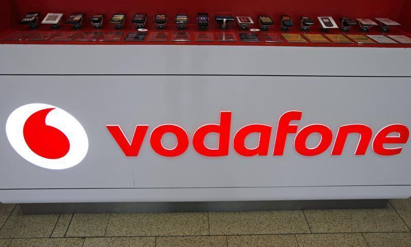 The Vodafone logo is seen at the counter of the shop in Prague