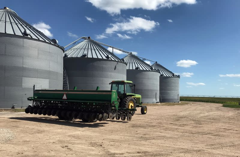 Grain bins are seen in front of crops at Knuth Farms in Mead, Nebraska